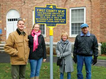 David and Claire Hollman, left, with Nelson town co-historians Fay Lyon and Laine Gilmore at the historical marker dedication ceremony on Nov. 14. (photo by Jason Emerson)