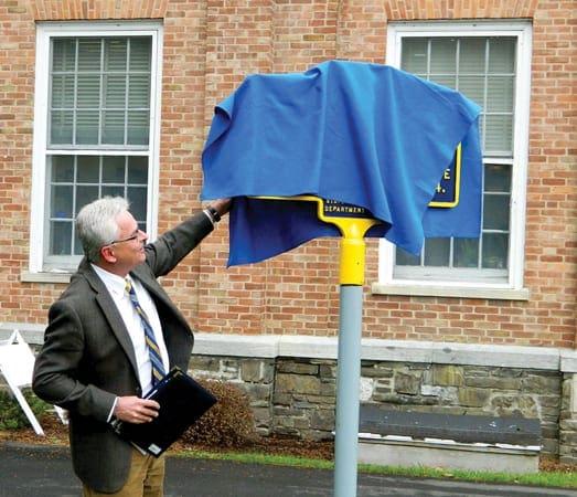 Cazenovia College President Ron Chesbrough prepares to unveil the marker. )photo by Jason Emerson)