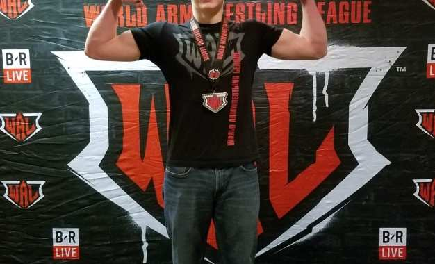 Hand-to-hand combat: Baker sophomore claims arm wrestling victory