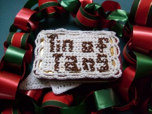 Tin of Tans in Christmas ribbon
