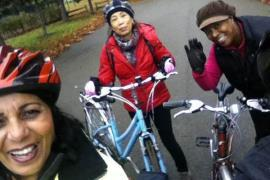 Three women cycling in the park
