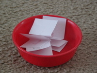 bowl with slips of paper in it
