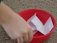 hand shaking bowl of papers