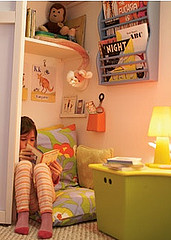 young girl cuddled in nook with book