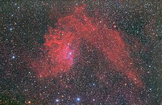 image of red nebula against black starry sky