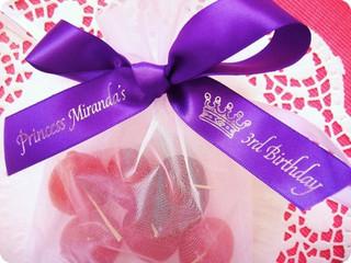 birthday gift with purple ribbon