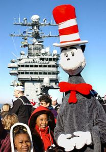 two children in front of ship with The Cat in The Hat