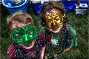 2 kids with plastic party masks on