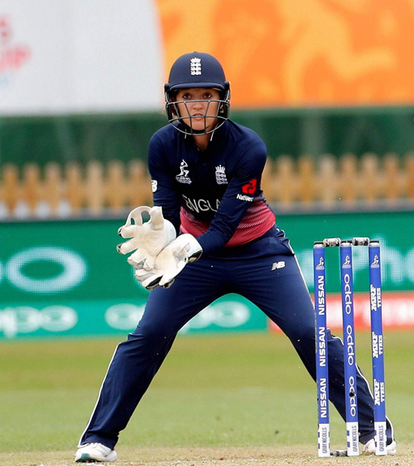 Sarah Taylor wearing England kit with Earnie