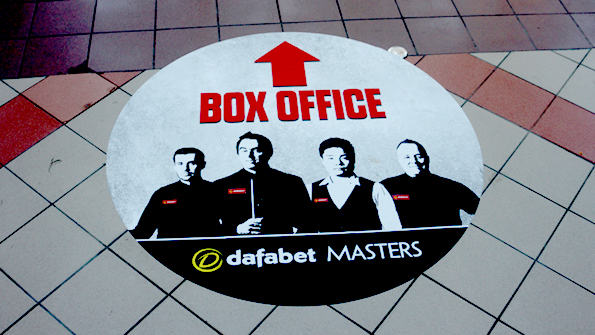 Photo of floor with box office arrow and central creative featuring Ronnie O