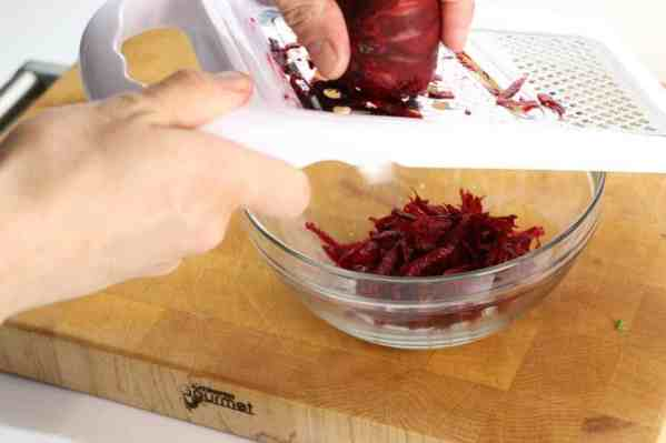 Shred the beets, carrot, and apple with a regular box grater or you can use a food processor with a grating attachment.