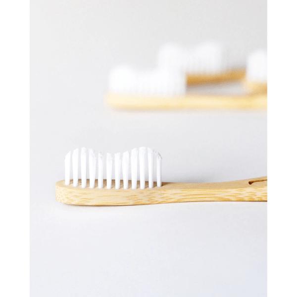 White bristle bamboo toothbrush