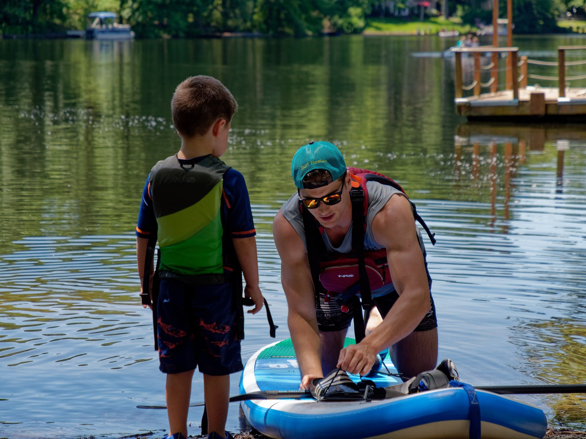 Small child beginner paddle boarder
