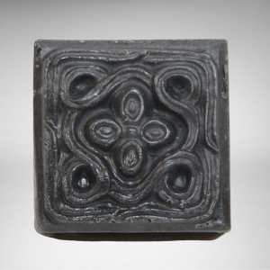 Square bar of natural vegan charcoal detox soap with floral and filigree design