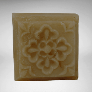 square bar of Lemongrass natural soap with design molded on front