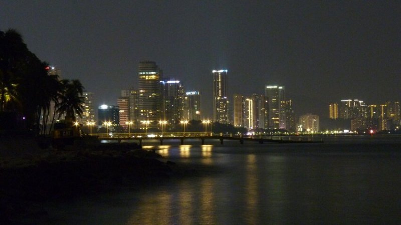 Nighttime city skyline of Penang, Malaysia, a good place for a slow travel budget.