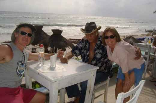 three people at an oceanfront cafe in Tulum, Mexico