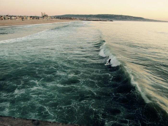 Surfing at the pier - Hermosa Beach, California
