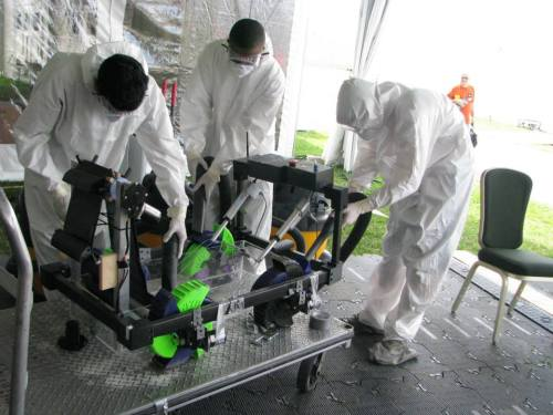 The team cleans the robot before our first run in the Arena.
