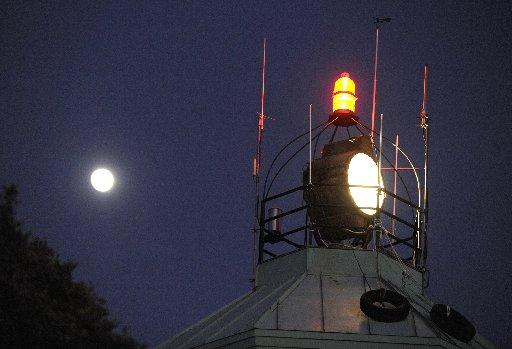 The moon shined bright next to the Pearl Harbor Remembrance Beacon atop Mount Diablo during the 2011 Pearl Harbor survivors ceremony. (Susan Tripp Pollard/Staff)