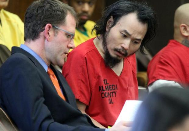 One Goh, of Alameda, accused of killing six people at Oikos University, talks with Assistant Public Defender David Klaus in court at Renee C. Davidson Superior Court House in Oakland on Jan. 28, 2013.