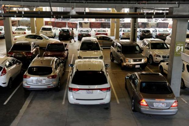 A motorist pulls into a vacant spot while others drive around competing for a popular ground level parking spot at the parking garage along S. Broadway near Broadway Plaza in Walnut Creek, Calif., Monday, July 13, 2015. The parking garages often reach capacity. (Susan Tripp Pollard/Bay Area News Group)
