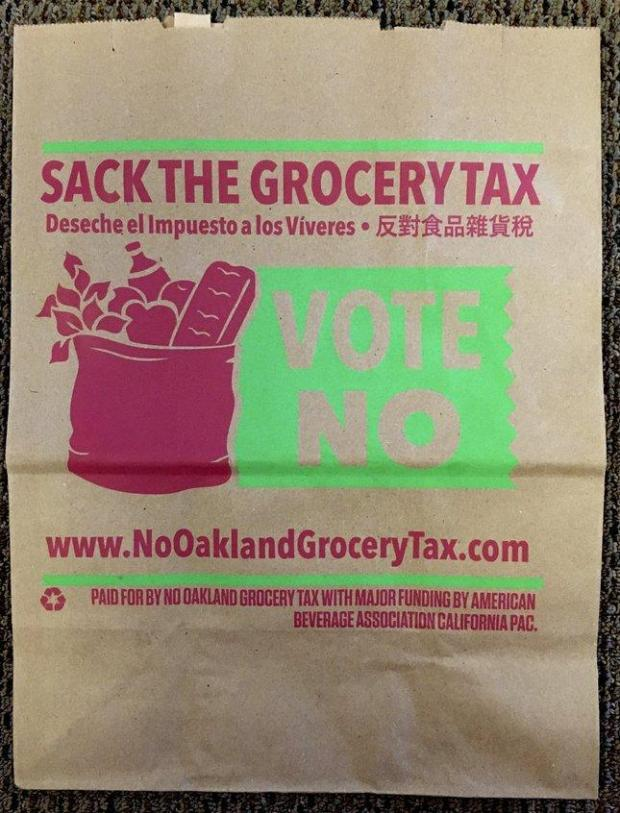 "The American Beverage Association, which has poured $600,000 to defeat a soda tax on the November ballot in Oakland, has sent mailers featuring local business owners opposed to the tax as well as a grocery bag. The association is calling the tax a ""grocery tax"". (Courtesy of No Oakland Grocery Tax)"