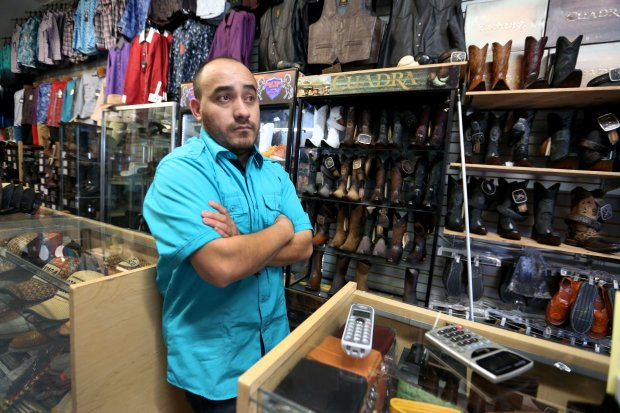 Jose Pulido, owner of Cuates Western Wear, says his business will be affected by the Rapid Bus Transit corridor in Oakland, Calif., on Tuesday, Aug. 30, 2016. The BRT corridor will be built along International Boulevard from San Leandro BART station to downtown Oakland. Pulido like most of the business owners located on International Boulevard think that many businesses will close due to the lack of parking spaces in the congested Fruitvale District. (Ray Chavez/Bay Area News Group)