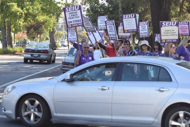 Members of Service Employees International Union Local No. 1021, taking part in a three-day strike of Contra Costa County health services facilities, get a vote of support from a passing motorist in front of the Contra Costa Regional Medical Center in Martinez Friday afternoon.