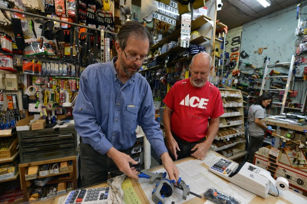 Patrick Eames, left, and brother Bob Eames sort through inventory as they work at their Ace hardware store in Richmond, Calif. on Thursday, Sept. 1, 2016. After 42 years, the Eames brothers have decided to retire and are closing the store. (Kristopher Skinner/Bay Area News Group)