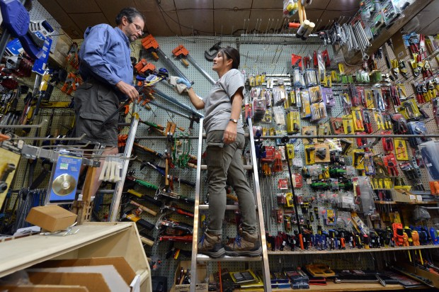 Patrick Eames, left, and Sonia Curtis work at the Eames brother's Ace hardware store in Richmond, Calif. on Thursday, Sept. 1, 2016. After 42 years, Patrick and Bob Eames  have decided to retire and are closing the store. (Kristopher Skinner/Bay Area News Group)