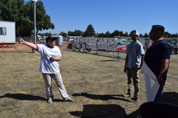 Cindy Pieslak, left, volunteer coordinator for East Bay Stand Down, guides a couple of volunteers to their tasks