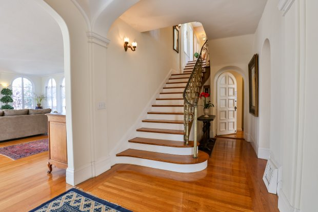 The interior staircase at Henry J. Kaiser's first California home, at 644 Haddon Road, currently for sale with an asking price of $1.85 million. Photo by Satbir Randhawa/Fusion Real Estate Network