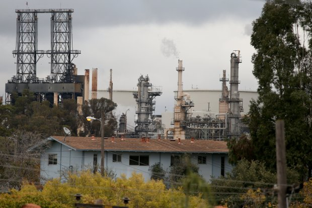 Homes in the Bayo Vista housing project are seen near the Phillips 66 refinery in Rodeo, Calif., on Friday, Oct. 28, 2016. (Anda Chu/Bay Area News Group)