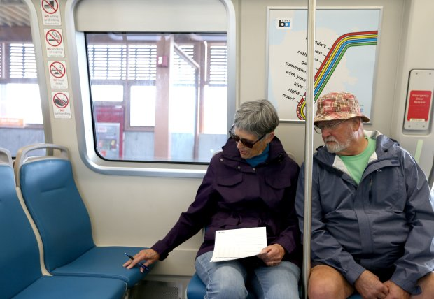 Joyce Mason and husband Jake Mason, of Pleasant Hill, from left, try out the seats on one of BART's new train cars at the Pleasant Hill station in Walnut Creek, Calif., on Saturday, Oct. 15, 2016. The agency is planning to replace its 669 train cars with 775 new ones, which will help expand capacity on the overcrowded system. (Anda Chu/Bay Area News Group)