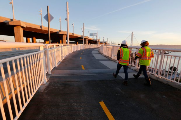 Caltrans spokesperson for the Bay Bridge Leah Robinson-Leach, right, talks to a reporter on the new portion of the Bay Bridge bike path leading to Yerba Buena Island in San Francisco, Calif., on Thursday, Oct. 20, 2016. The bike path on the new Bay Bridge has been completed and will open this weekend allowing bicyclists, walkers and runners an open path from the East Bay to Yerba Buena Island and Treasure Island. (Laura A. Oda/Bay Area News Group)