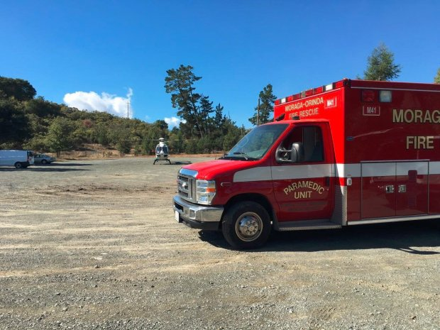 A burn victim was flown to the hospital after a vehicle collision and vegetation fire Tuesday afternoon on Canyon Road in Moraga, authorities said. (Moraga-Orinda Fire District)