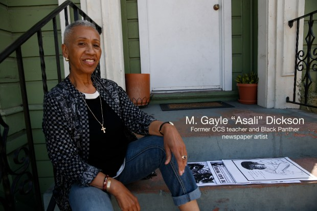 Former Black Panther artist M. Gayle Asali Dickson is photographed with copies of the Black Panther newspaper containing some of her drawings at the former Black Panther Party Office #4, at 1048 Peralta Street in West Oakland, Calif., on Thursday, Sept. 29, 2016. Dickson worked out of the office as an artist for the Panther's newspaper. (Jane Tyska/Bay Area News Group)