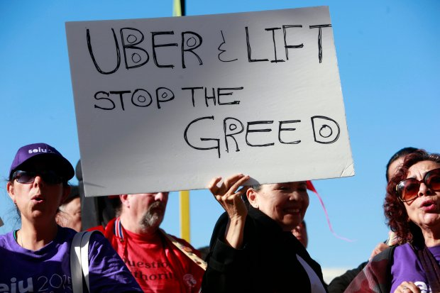 "Among protesters from fast food, airport, and other industries were workers of Uber and Lyft rallying during national ""Fight for $15"" day outside San Francisco International Airport Tuesday, Nov. 28, 2016, in San Francisco, Calif. (Karl Mondon/Bay Area News Group)"