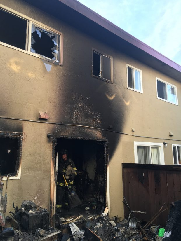 Alameda County firefighters inspect an apartment complex in the 1600 block of 164th Avenue in Ashland after a two-alarm fire. Officials said 21 residents from five units were displaced. (Alameda County Fire Department)