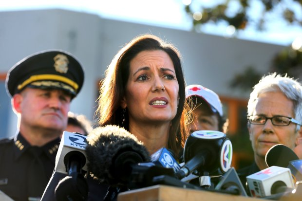Oakland Mayor Libby Schaaf, center, and other officials give updates on the fatal fire where at least nine people died in a warehouse party on 31st Avenue in Oakland, Calif., on Saturday, Dec. 3, 2016. (Ray Chavez/Bay Area News Group)