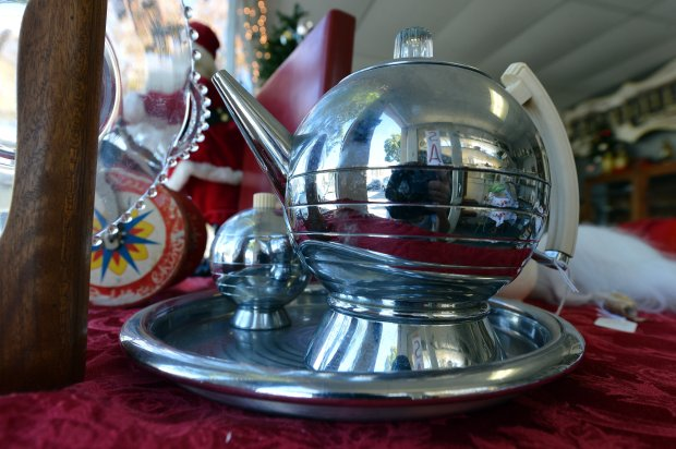 A chrome tea set is seen at Sisters Antiques, a mainstay for many years on Solano Ave. that will soon be closing its doors, in Albany, Calif., on Wednesday, Dec. 21, 2016. (Kristopher Skinner/Bay Area News Group)