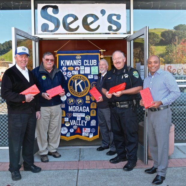 Kiwanis of Moraga Valley members, from left, president Sam Sperry, Moraga Mayor Mike Metcalf, Moraga Town Manager Bob Preibe, Moraga Chief of Police Jon King and Jon Nickens, trustee and vice president of the Moraga School Board, joined forces on the opening day of the Kiwanis See's Candy Holiday Shops in the Rheem Shopping Center and the Moraga Shopping Center, to sell or ship candy through Dec. 24. Part of the funds remaining with Kiwanis support the Moraga Educational Foundation, the Educational Foundation of Orinda, and Lafayette Partners in Education.