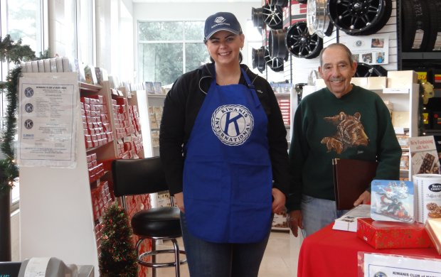 Martinez Kiwanis Club members Tina Busker and John Surges sell See's Candies at Les Schwab Tires, 3800 Alhambra Ave., in Martinez, to raise funds for community grants and scholarships.