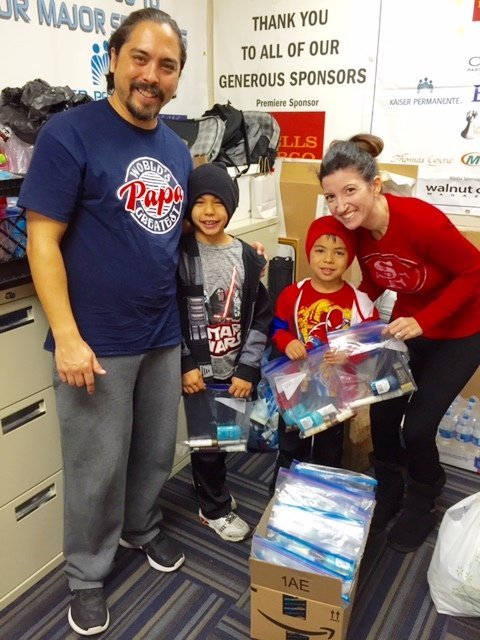 The Chris Arnold family from Martinez, including Pierce, Preston, and Jessica, recently donated more than 50 bags of toiletry items and holiday food bags for Loaves & Fishes clients in Martinez.