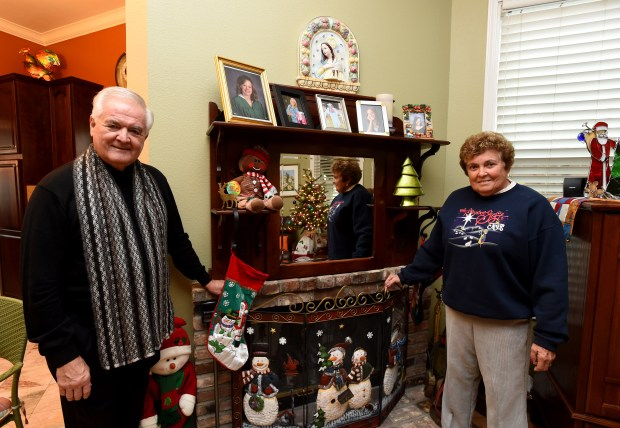 Father Richard Mangini and his sister Karen Mangini stand near a mantel that dates back to the late 1800s at the Mangini home in Concord, Calif., on Wednesday, Nov. 30, 2016. The home will be on the Clayton Historical Society's seventh annual Christmas Home Tour. (Susan Tripp Pollard/Bay Area News Group)