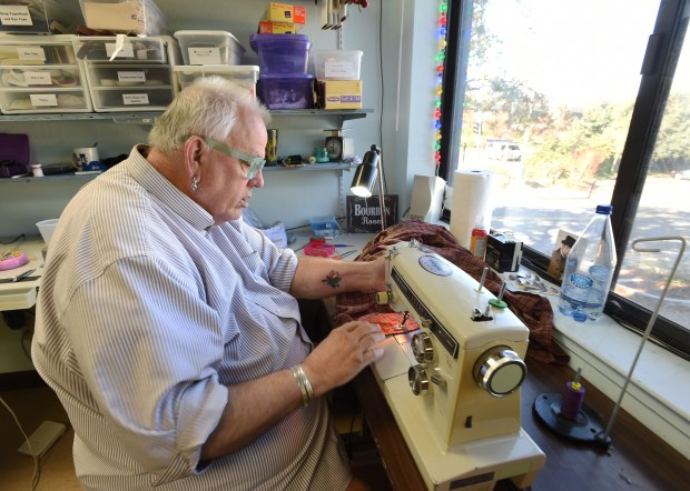 """The skirt that the character Mrs. Cratchit will wear in Lesher Center Repertory's """"A Christmas Carol"""" is stitched by costumer Michael Berg at the costume shop for productions at the Lesher Center in Walnut Creek, Calif., on Thursday, Dec. 1, 2016. (Susan Tripp Pollard/Bay Area News Group)"""