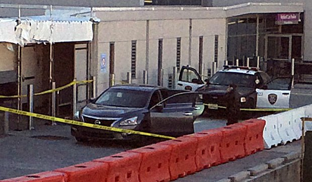 A car that a 22-month-old was shot in is being searched by police at Highland Hospital where the toddler was taken on Thursday, Jan. 5, 2017. (Harry Harris/ Bay Area News Group)