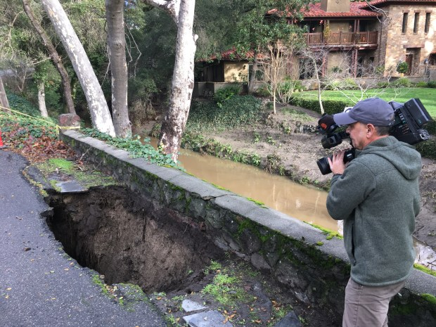 Police closed off streets near a large sink hole at Camino Lenada in Orinda on Wednesday morning. (Laura Oda/Bay Area News Group)