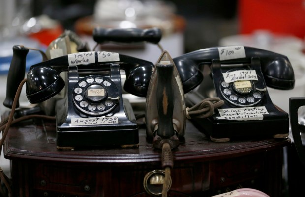 Old rotary telephones are seen at the White Elephant Sale warehouse in Oakland, Calif., on Wednesday, Jan. 19, 2017. The 58th annual White Elephant Sale will be held March 4-5 at 333 Lancaster Street. A preview sale takes place Sunday, January 29, from 10 a.m. to 4 p.m. Proceeds from the sale, which has raised over $2 million dollars each of the past two years, will benefit the Oakland Museum of California. (Jane Tyska/Bay Area News Group)